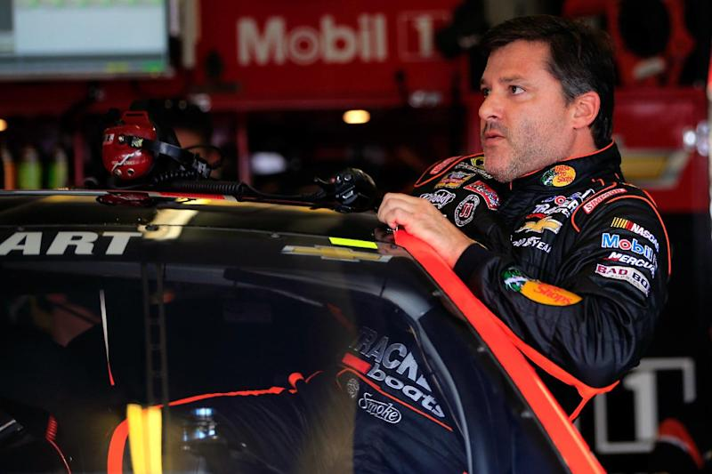 Tony Stewart climbs into his car prior to practice for the NASCAR Sprint Cup Series Oral-B USA 500 at Atlanta Motor Speedway on August 29, 2014 in Hampton, Georgia