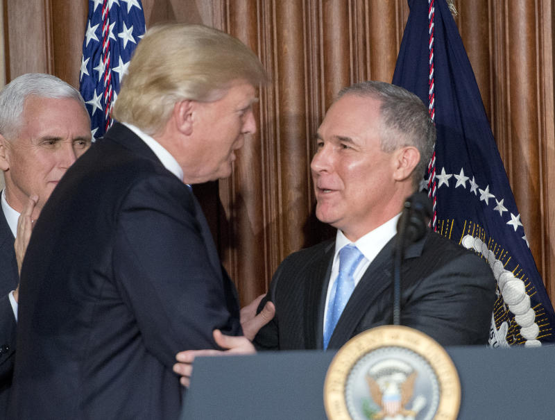 President Donald Trump and his EPA administrator, Scott Pruitt, have both deneid climate change is real. (Ron Sach/pool photo/Getty Images)