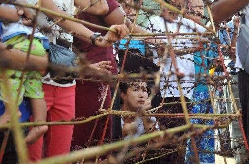 Family members of prisoners wait for their release outside the Insein central prison in Yangon on October 12. Myanmar faced calls on Thursday to free its remaining political prisoners as the opposition expressed disappointment with a much-anticipated amnesty that left most key dissidents behind bars