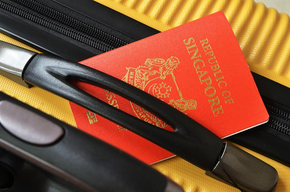 A Singapore passport on a luggage. (PHOTO: Getty Images)