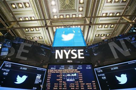 The Twitter Inc. logo is displayed on screens prior to its IPO on the floor of the New York Stock Exchange in New York, November 7, 2013. REUTERS/Lucas Jackson