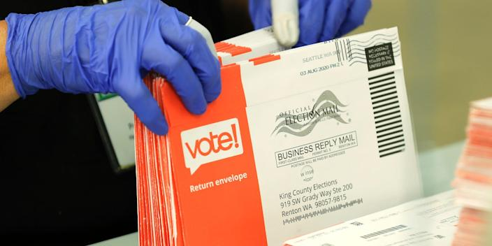 """A worker processing mailed-in ballots on August 5 at the King County Elections headquarters in Renton, Washington. <p class=""""copyright"""">Ted Warren/AP</p>"""