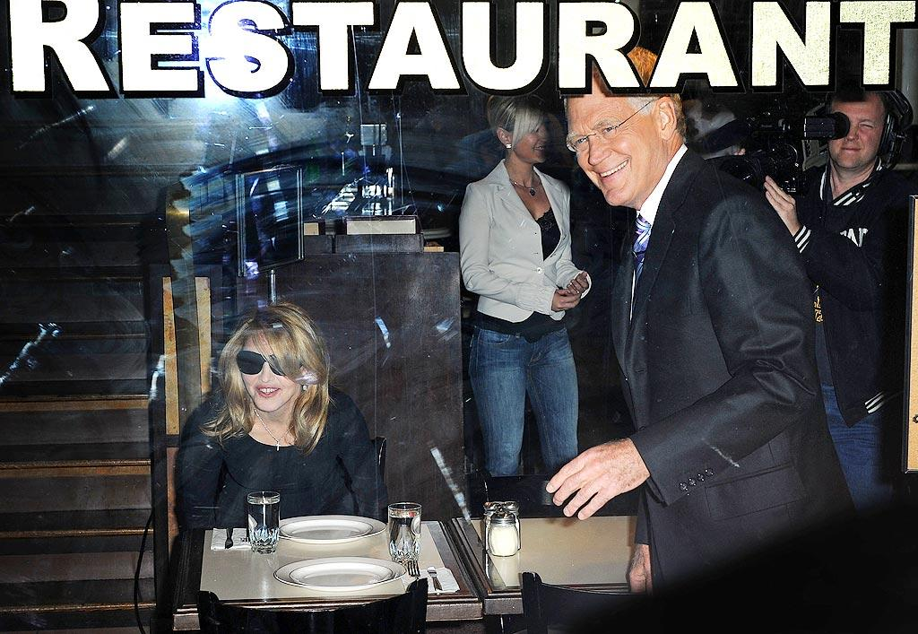 "The pop star takes a seat at Angelo's Pizza. Letterman took Madonna to the nearby restaurant after learning she'd never been to a New York City pizza parlor. James Devaney/<a href=""http://www.wireimage.com"" target=""new"">WireImage.com</a> - September 30, 2009"