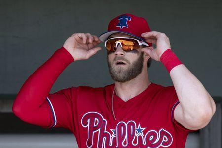 FILE PHOTO: Mar 15, 2019; Clearwater, FL, USA; Philadelphia Phillies outfielder Bryce Harper (3) stands in the dugout prior to the game between the Philadelphia Phillies and the Toronto Blue Jays at Spectrum Field. Mandatory Credit: Douglas DeFelice-USA TODAY Sports