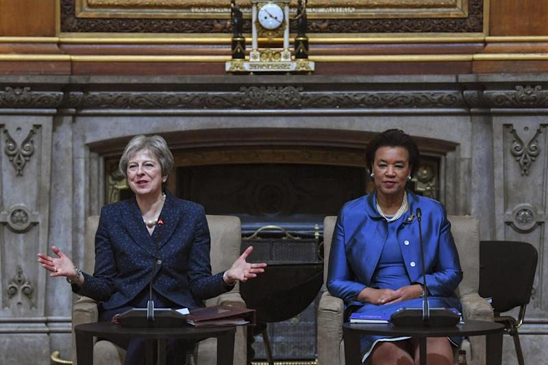 Address: Theresa May speaks during a CHOGM meeting at Waterloo chamber at Windsor Castle (EPA)