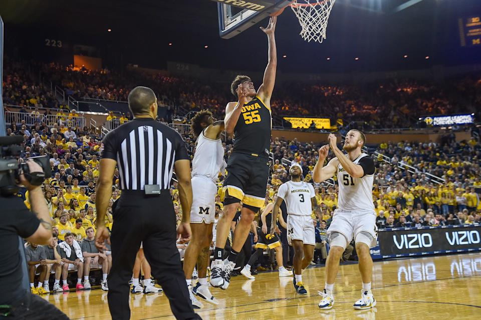 ANN ARBOR, MICHIGAN - DECEMBER 6: Luke Garza #55 of the Iowa Hawkeyes scores a basket during the first half of a college basketball game against the Michigan Wolverines at Crisler Arena on December 6, 2019 in Ann Arbor, Michigan.  Garza scored a game high 44 points in the loss to the Michigan Wolverines 91-103.  (Photo by Aaron J. Thornton/Getty Images)