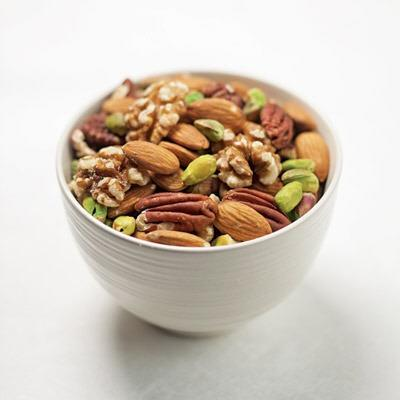 "Nuts  					<p class=""caption""><strong>The bad rap:</strong> Nuts are chock-full of fat. <br><br> <strong>The good news:</strong> Nuts are full of fats—but they're the  good, heart-healthy unsaturated kinds. Nuts, and peanuts, which are  technically legumes, also deliver other healthy nutrients—which ones  depends on the nut. For example, pistachios are rich in lutein and  zeaxanthin, antioxidants that help keep eyes healthy. Almonds provide  vitamin E and walnuts offer significant amounts of heart-healthy omega-3  fats. You do need to keep an eye on serving size, though: at around 160  to 200 calories per ounce, nuts do pack a substantial amount of  calories.</p>"
