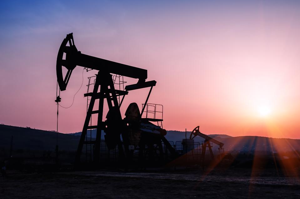 oil pump silhouette on the beautiful red sunset