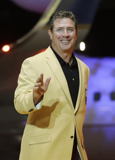Dan Marino is introduced before the inaugural Pro Football Hall of Fame Fan Fest Friday, May 2, 2014, at the International Exposition Center in Cleveland. (AP Photo/Mark Duncan)