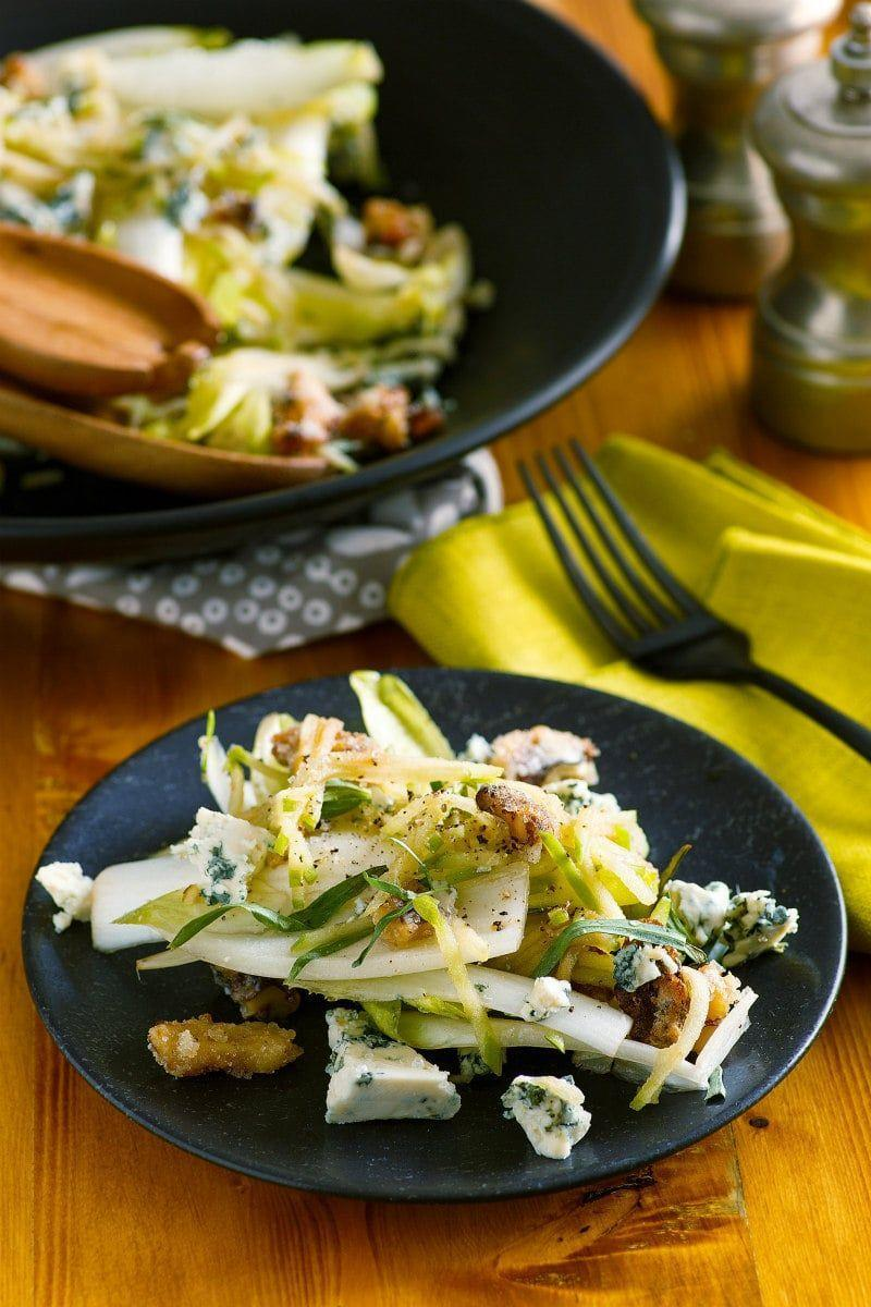 """<p>Set yourself up for holiday success with an elegant starter, like this endive salad, that will have everyone impressed. The sugared walnuts really take it to the next level. </p><p><strong>Get the recipe at <a href=""""https://www.recipegirl.com/apple-endive-salad-with-sugared-walnuts/"""" rel=""""nofollow noopener"""" target=""""_blank"""" data-ylk=""""slk:Recipe Girl"""" class=""""link rapid-noclick-resp"""">Recipe Girl</a>.</strong></p>"""