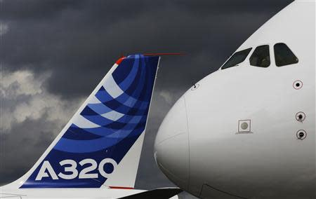 File photograph shows the nose cone of an Airbus A380 next to the tail fin of an Airbus A320 at the Farnborough Airshow 2012 in southern England