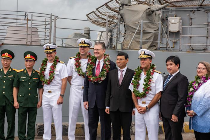 U.S. Ambassador to Vietnam Daniel Kritenbrink, center, Adm. John C. Aquilino, right, commander of U.S. Pacific Fleet, Rear Adm. Stu Baker, center-left, commander of Carrier Strike Group Nine, and Capt. Brett Crozier, commanding officer of the aircraft carrier USS Theodore Roosevelt (CVN 71) arrive in Da Nang, Vietnam, March 5, 2020. (Mass Communication Specialist 3rd Class Nicholas V. Huynh/U.S. Navy)