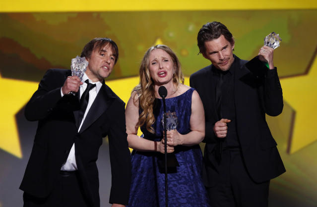 Actress and writer Julie Delpy accepts the Louis XIII Genius Award along with director and writer Richard Linklater (L) and actor Ethan Hawke at the 19th annual Critics' Choice Movie Awards in Santa Monica, California January 16, 2014. REUTERS/Mario Anzuoni (UNITED STATES Tags: ENTERTAINMENT)(CRITICSCHOICE-SHOW)