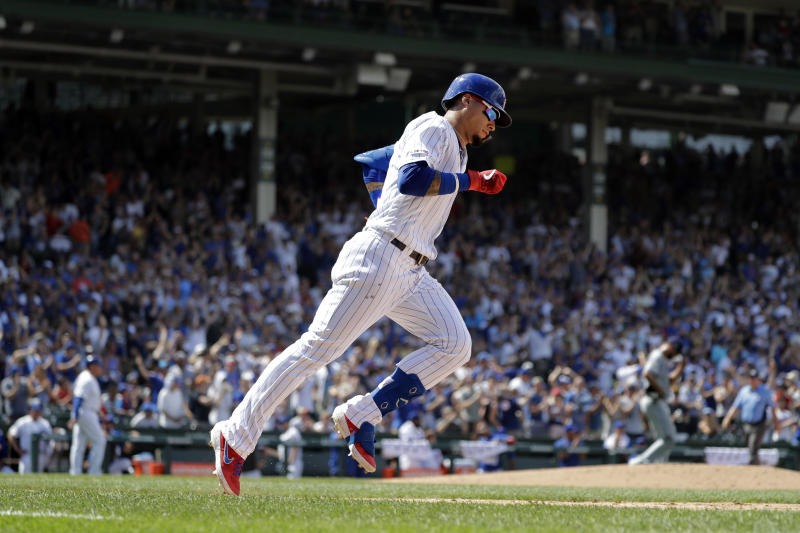 Chicago Cubs' Javier Baez rounds the bases after hitting a three-run home run during the fourth inning of a baseball game against the San Diego Padres in Chicago, Saturday, July 20, 2019. (AP Photo/Nam Y. Huh)