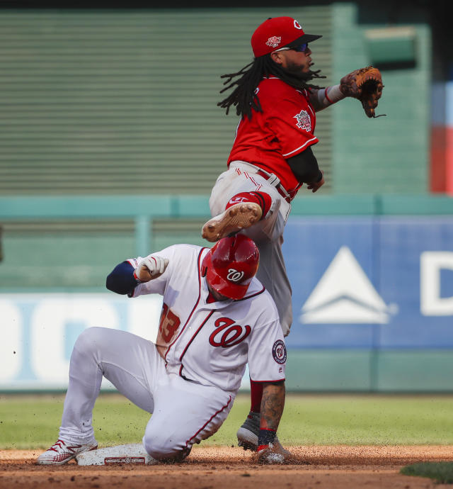 Cincinnati Reds second baseman Freddy Galvis gets tangled up with Washington Nationals' Asdrubal Cabrera who was out at second base on the fielder's choice during the fifth inning of a baseball game at Nationals Park, Wednesday, Aug. 14, 2019, in Washington. (AP Photo/Alex Brandon)