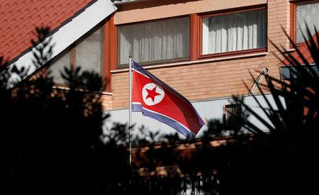 FILE PHOTO: The flag of North Korea flutters in front of its embassy in Rome, Italy, January 3, 2019. REUTERS/Alessandro Bianchi