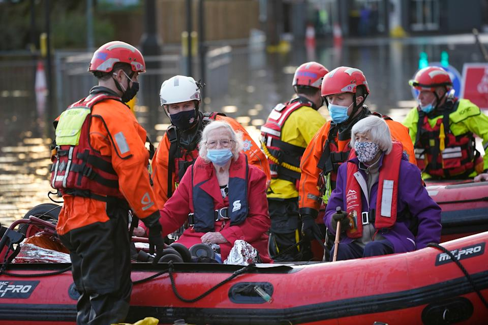 NORTHWICH, ENGLAND - JANUARY 21: Elderly residents are evacuated from a local care home by Fire and Rescue emergency services personnel on January 21, 2021 in Northwich, United Kingdom. The first named storm of 2021 has swept across North of England and Scotland bringing flooding and heavy snow. (Photo by Christopher Furlong/Getty Images) (Photo: Christopher Furlong via Getty Images)