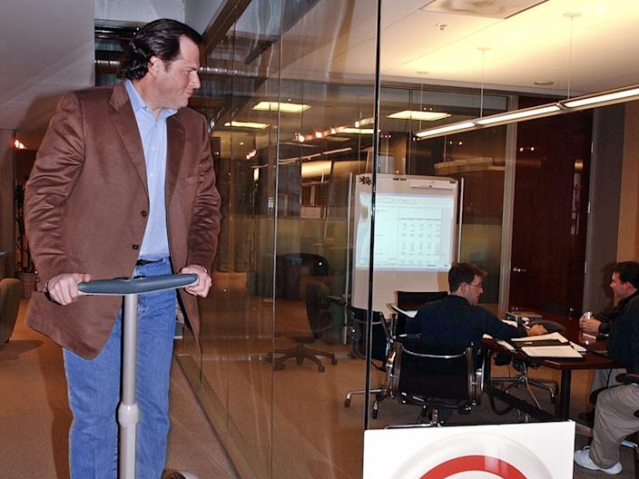 Salesforce CEO Marc Benioff rides a Segway around one of Salesforce's earliest office spaces.