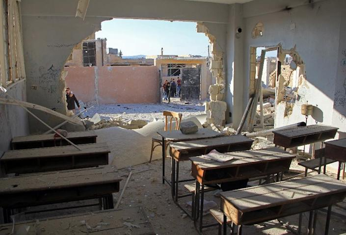 A damaged classroom at a school after it was hit in an air strike in the village of Hass, in the south of Syria's rebel-held Idlib province on October 26, 2016 (AFP Photo/Omar haj kadour)