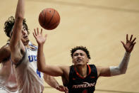 Pepperdine guard Colbey Ross, right, loses the ball as UCLA guard Jaime Jaquez Jr., left, defends during the second half of an NCAA college basketball game Friday, Nov. 27, 2020, in San Diego. (AP Photo/Gregory Bull)