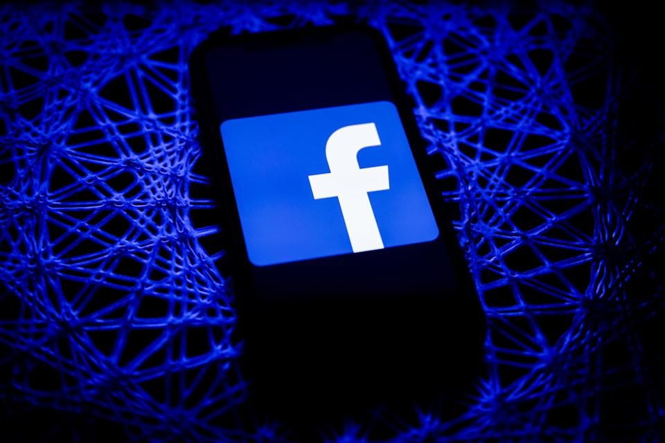 Facebook logo displayed on iPhone screen is seen in this illustration photo taken in Poland on February 8, 2021. Facebook reacted negatively to Apple's privacy policy changes. (Photo illustration by Jakub Porzycki/NurPhoto via Getty Images)