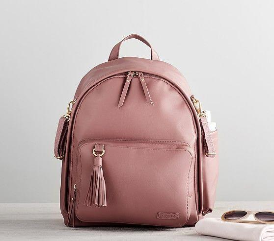 This sleek, modern backpack combines laid-back luxury with functionality. Plus, it comes with nine spacious pockets and a cushioned changing pad.