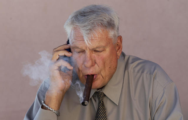 Don Nelson's smoking habits have evidently changed a bit since this photo was taken in August of 2012. (AP)