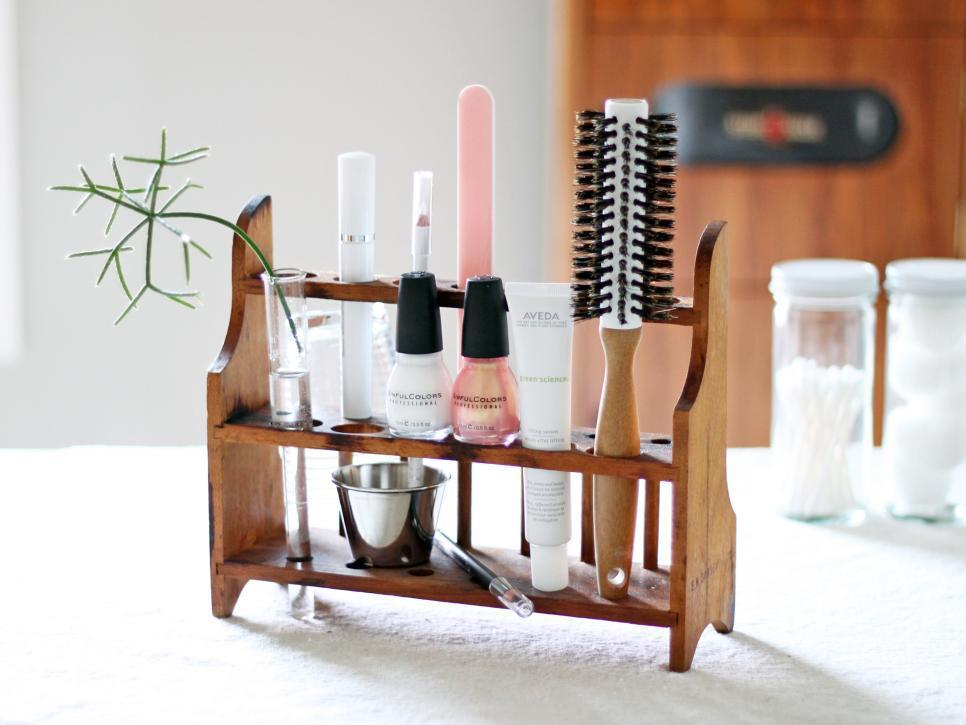 """<p>A vintage test-tube rack keeps all your grooming tools neatly in one place. Brushes, nail polish and nail files fit perfectly in the test-tube compartments, giving your bathroom an organized look and keeping everything conveniently at your fingertips. Design by <a href=""""http://www.etsy.com/shop/HRUSKAA"""">Melissa Hruska</a>.</p>"""