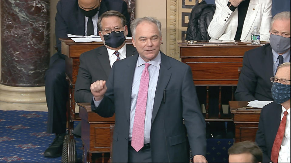 In this image from video, Sen. Tim Kaine, D-Va., speaks as the Senate reconvenes after protesters stormed into the U.S. Capitol on Wednesday, Jan. 6, 2021. (Senate Television via AP)