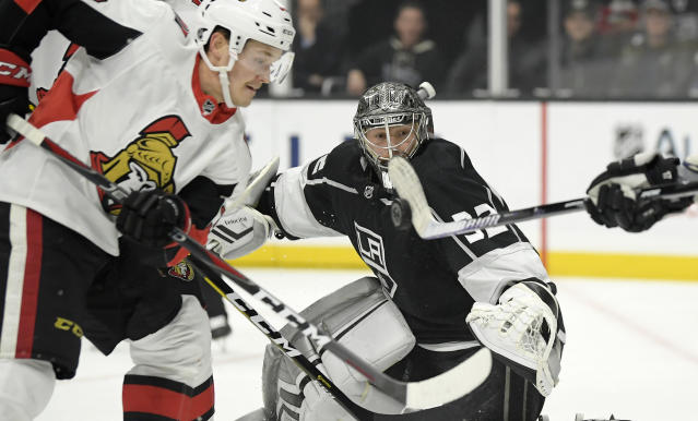 Los Angeles Kings left wing Ilya Kovalchuk, right, blocks a shot with his stick as Ottawa Senators left wing Rudolfs Balcers, left, battles in front of the net and goaltender Jonathan Quick watches during the first period of an NHL hockey game Thursday, Jan. 10, 2019, in Los Angeles. (AP Photo/Mark J. Terrill)