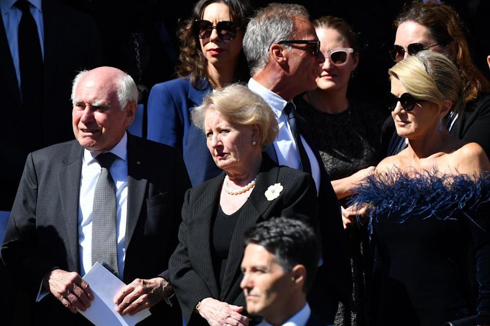 John and Janette Howard, and Julie Bishop are among the mourners