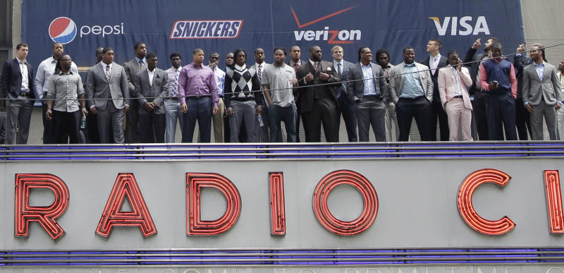 The 2012 NFL draft prospects pose for a group photo atop the Radio City Music Hall's marquee, Wednesday, April 25, 2012, in New York. (AP Photo/Mary Altaffer)