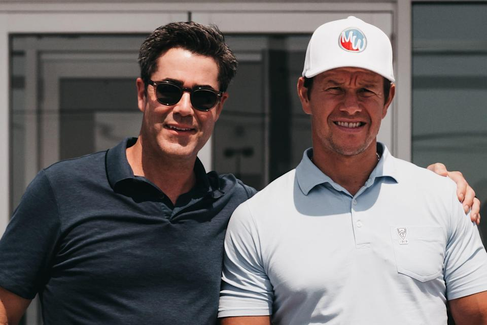 Finding time for a good game of golf is a part of most visits between Jay Feldman (left) and Mark Wahlberg (right). Feldman doesn't golf but he accompanies Wahlberg, an avid golfer.