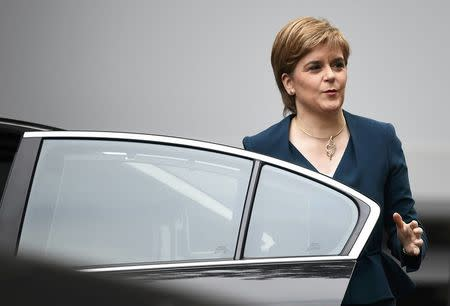 Nicola Sturgeon, First Minister of Scotland smiles as she arrives at Downing Street in London, Britain October 24, 2016. REUTERS/Dylan Martinez