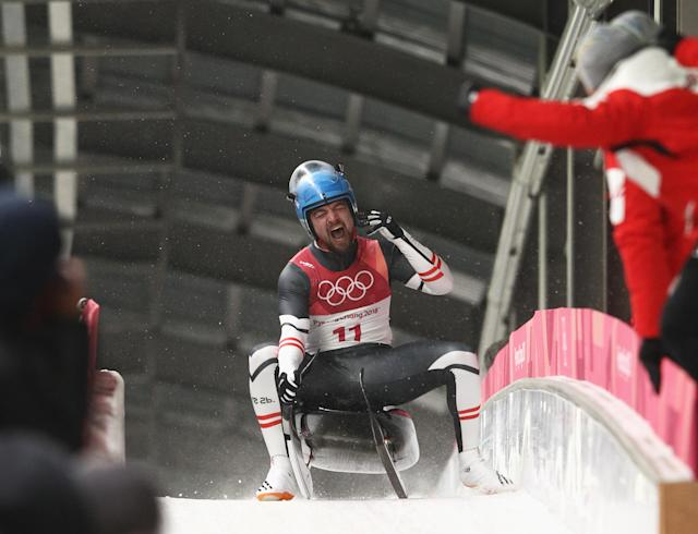 <p>David Gleirscher of Austria celebrates winning the gold following run 4 during the Luge Men's Singles on day two of the PyeongChang 2018 Winter Olympic Games at Olympic Sliding Centre on February 11, 2018 in Pyeongchang-gun, South Korea. (Photo by Adam Pretty/Getty Images) </p>