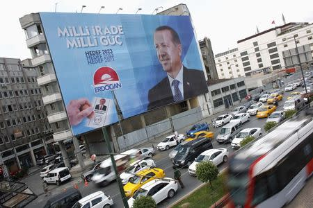 A huge election campaign banner of Turkey's Prime Minister and presidential candidate Tayyip Erdogan hangs on a building in Istanbul