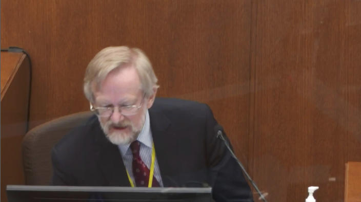 In this image from video, Dr. Martin Tobin regards the screen in front on him as he testifies Thursday, April 8, 2021, in the trial of former Minneapolis police Officer Derek Chauvin at the Hennepin County Courthouse in Minneapolis, Minn. Chauvin is charged in the May 25, 2020 death of George Floyd. (Court TV via AP, Pool)