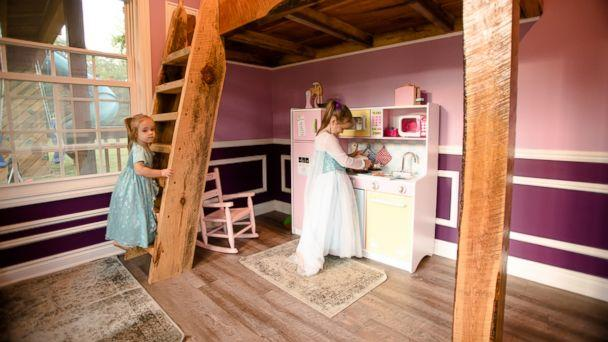 PHOTO: Michigan dad Adam Boyd built his daughters an amazing two-story playhouse with porches, a rock wall and 8-foot ceilings. (Flashes of Life Photography)