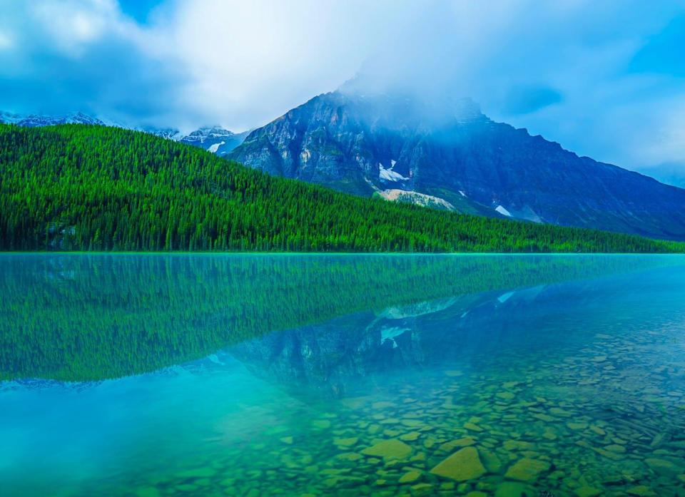 """<span class=""""caption"""">Canada's latest federal budget did little to tackle climate action or income inequality, two problems with strong ties. Alberta's Bow Lake is seen in this photo.</span> <span class=""""attribution""""><span class=""""source"""">Josh Woroniecki/Unsplash</span></span>"""