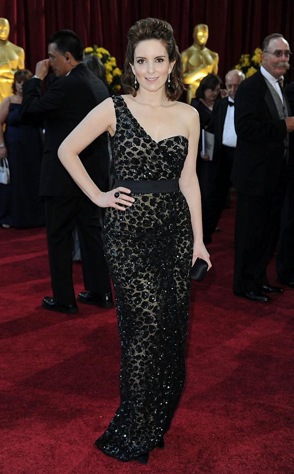 """Tina Fey   Grade: A-    Although the """"30 Rock"""" funny lady has had some fashion flops recently on the red carpet, she put her best foot forward at the Oscars in a muted leopard print Michael Kors gown. We're not really feeling the hair, but she wins our vote for most improved."""