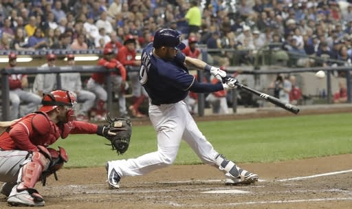 Milwaukee Brewers' Manny Pina hits a three-run home run during the sixth inning of a baseball game against the Cincinnati Reds Wednesday, Sept. 19, 2018, in Milwaukee. (AP Photo/Morry Gash)
