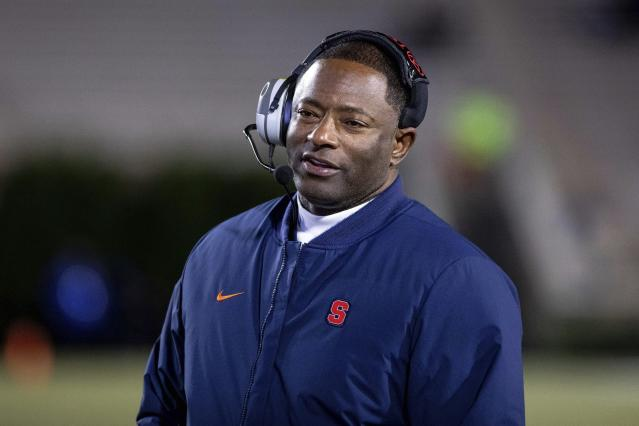 File-This Nov. 16, 2019, file photo shows Syracuse Head Coach Dino Babers smiling on the sideline during an NCAA college football game against Duke in Durham, N.C.Syracuse has a terrific 1-2 punch in punter Sterling Hofrichter and place-kicker Andre Szmyt. Together theyve helped the Orange excel on special teams for a second straight season. Hofrichter has landed 93 of his 255 career punts inside the 20-yard line with only 13 touchbacks. (AP Photo/Ben McKeown, File)