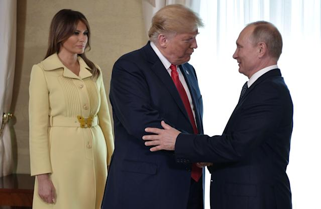 <p>U.S. President Donald Trump shakes hands with Russia's President Vladimir Putin next to U.S. First Lady Melania Trump ahead a meeting in Helsinki, on July 16, 2018. (Photo: Aleksey Nikolskyi/AFP/Getty Images) </p>