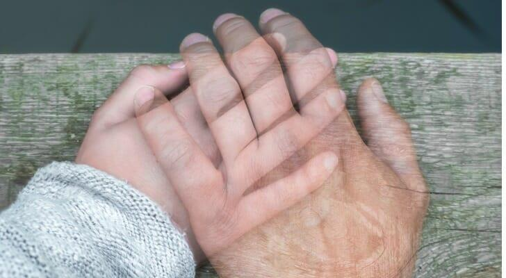 Semi-transparent hand on another hand