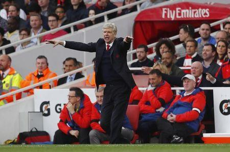 Gael Clichy backs under-fire Arsenal boss Arsene Wenger