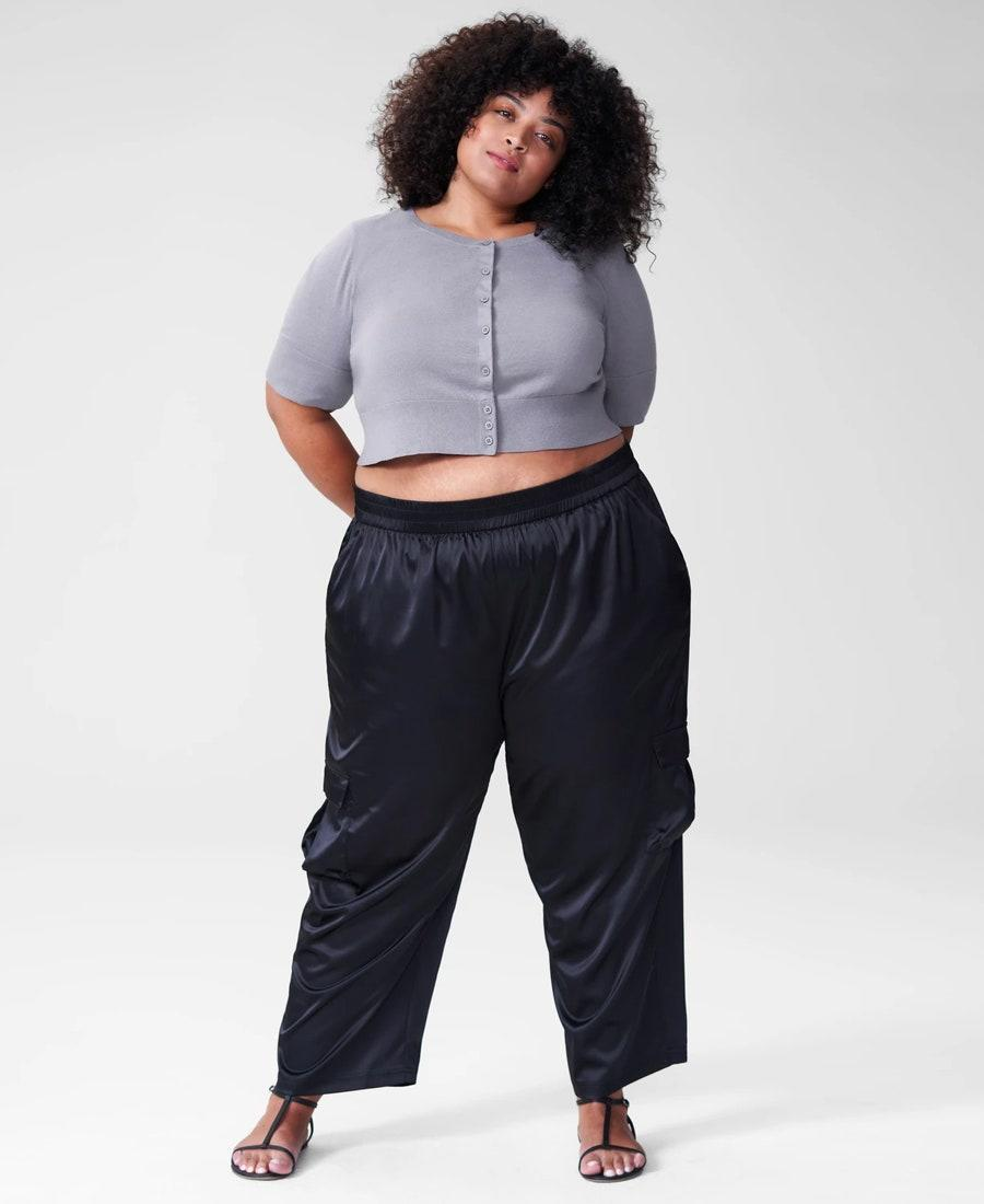 """The kind of cropped cardigan that looks great with <a href=""""https://www.glamour.com/story/best-bike-shorts?mbid=synd_yahoo_rss"""" rel=""""nofollow noopener"""" target=""""_blank"""" data-ylk=""""slk:bike shorts"""" class=""""link rapid-noclick-resp"""">bike shorts</a>, <a href=""""https://www.glamour.com/story/best-work-pants-women?mbid=synd_yahoo_rss"""" rel=""""nofollow noopener"""" target=""""_blank"""" data-ylk=""""slk:wide-leg trousers"""" class=""""link rapid-noclick-resp"""">wide-leg trousers</a>, and <a href=""""https://www.glamour.com/gallery/best-high-waisted-jeans?mbid=synd_yahoo_rss"""" rel=""""nofollow noopener"""" target=""""_blank"""" data-ylk=""""slk:high-waist denim"""" class=""""link rapid-noclick-resp"""">high-waist denim</a>. $65, Universal Standard. <a href=""""https://www.universalstandard.com/products/corinne-cardigan-lavender-grey"""" rel=""""nofollow noopener"""" target=""""_blank"""" data-ylk=""""slk:Get it now!"""" class=""""link rapid-noclick-resp"""">Get it now!</a>"""
