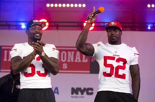 San Francisco 49ers linebackers NaVorro Bowman, left, and Patrick Willis acknowledge the crowd as they are interviewed together on stage during an NFL fan rally in Trafalgar Square, London, Saturday, Oct. 26, 2013. The San Francisco 49ers are due to play the the Jacksonville Jaguars at Wembley stadium in London on Sunday, Oct. 27 in a regular season NFL game. (AP Photo/Matt Dunham)