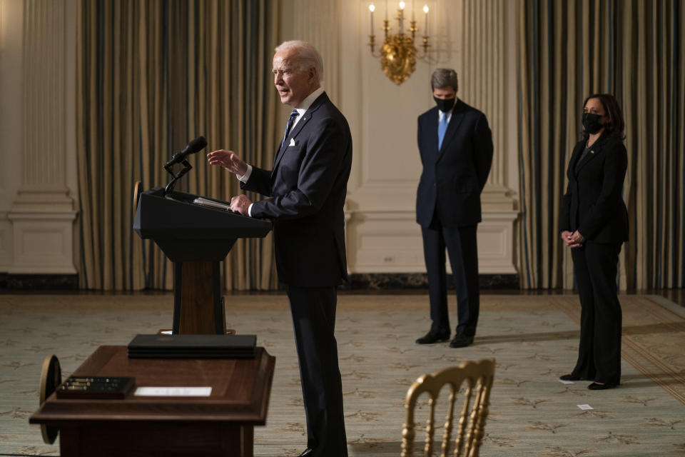 Special Presidential Envoy for Climate John Kerry, center, and Vice President Kamala Harris, right, listen as President Joe Biden delivers remarks on climate change and green jobs, in the State Dining Room of the White House, Wednesday, Jan. 27, 2021, in Washington. (AP Photo/Evan Vucci)