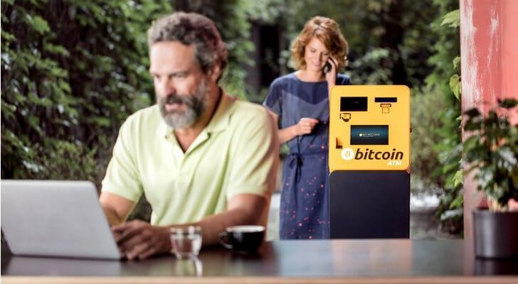 Couple at a cafe with a Bitcoin ATM