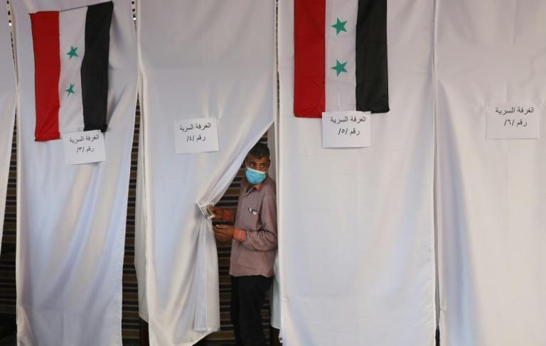 A Syrian voter in Lebanon casts his ballot on May 20, ahead of the main day of voting on Wednesday